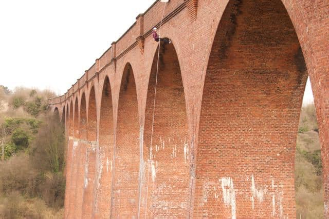 Abseiling from a bridge