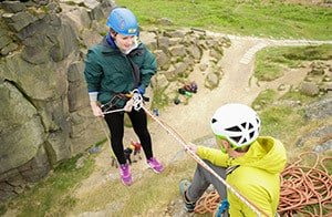 Abseiling off a cliff