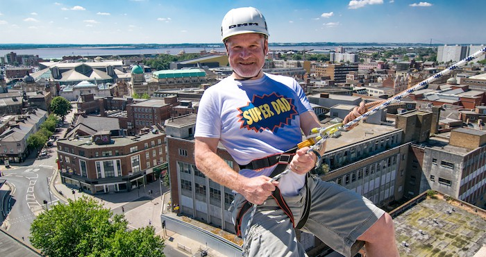 Man abseiling down building in Yorkshire