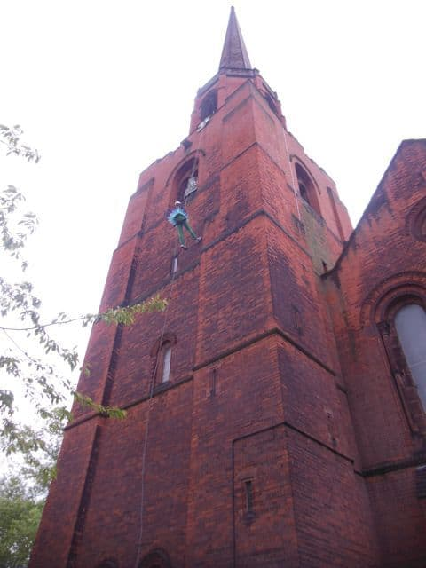 Abseiling down a church