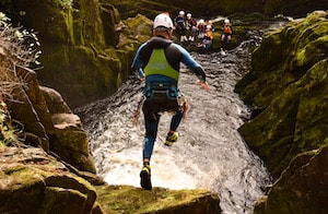 Adventure training in a gorge, recruit is jumping into a river