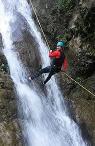 abseiling-down-waterfall