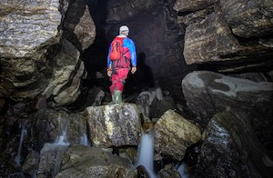 Caving beginners in large cave in Yorkshire