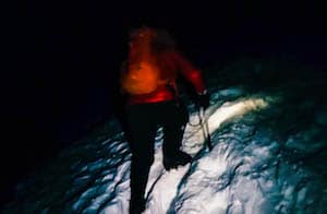 Climber in the snow at night