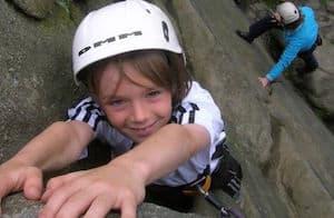 School Child Rock Climbing