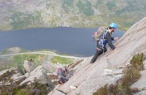 Tryfan scrambling rock climber