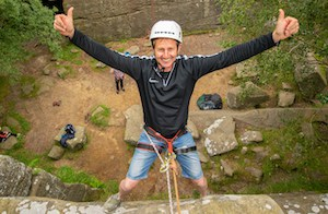 Abseiling man