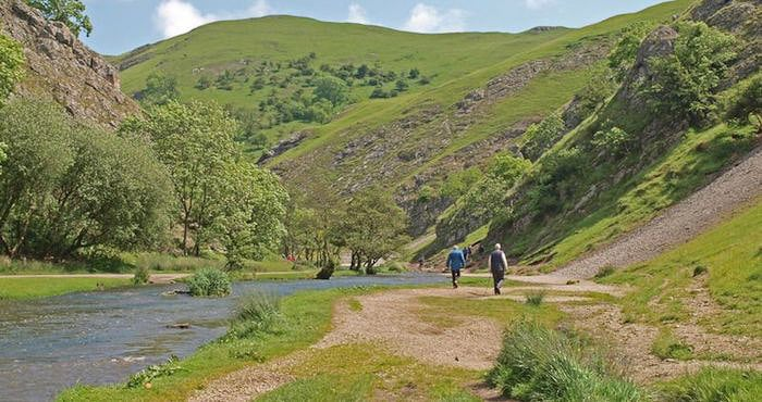 People walking through Dovedale in the Peak District