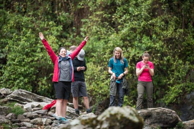 Group-Trekking-Forest-Boulders