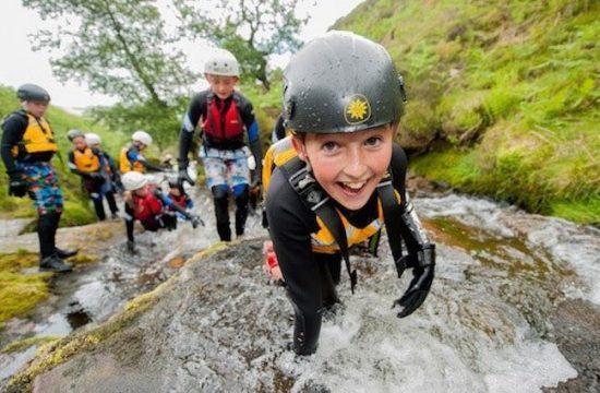 School child learns outside classroom on gorge walking adventure