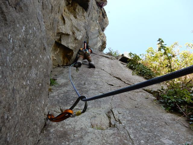 Man-Lead-Climbing-Placing-Gear
