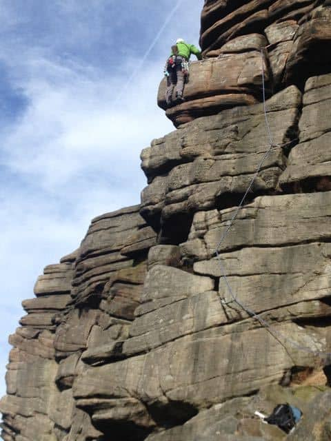 Man-Leading-Climb-Peak-District-Stanage