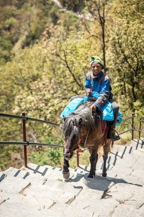 Man-Riding-Donkey-Nepal-Mountains