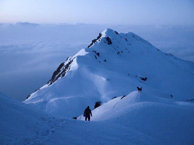Man-Trekking-Clouds-Makalu-Peak