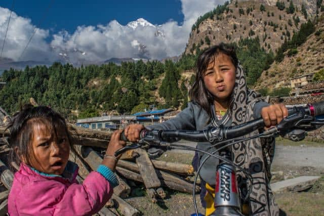 Nepalese-Children-Playing-With-Mountain-Bike