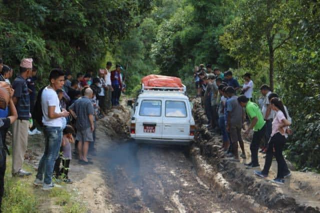 Nepalese-Crowd-Car-Mud-Path