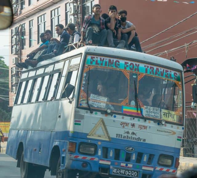 People-travelling-on-roof-of-bus