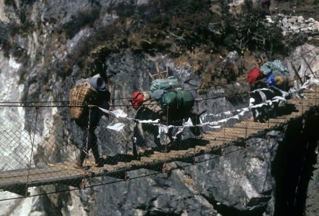 Porter_and_a_couple_of_Yaks_on_a_suspension_bridge_20