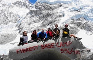 Team pose next to Everest Base Camp
