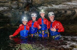 Family exploring caves in the Peak District