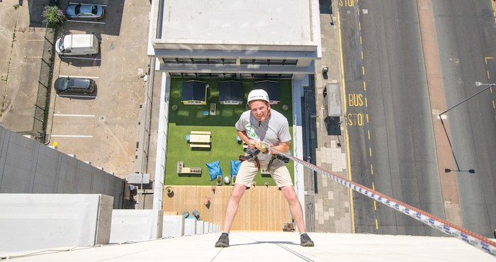 Man urban abseiling for charity event