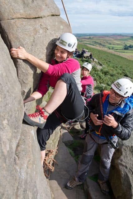 Woman-Climbing-Lay-Back-Technique-Peak-District