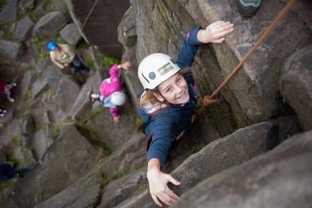 school-child-rock-climbing-outside copy